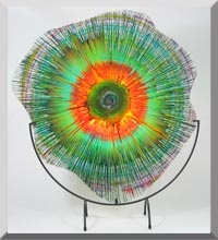 Dennis DeBon's Energy Webs- Spin art on sheet of glass, then heated to fuse paint to glass