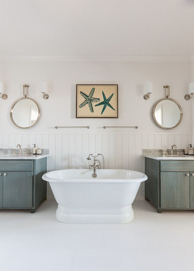 pictures to hang in master bathroom%0A Beach House with Turquoise Interiors  Master Bathroom  Upper walls painted  in white and lower walls with vertical shiplap  Arteriors Lander Iron  Mirrors