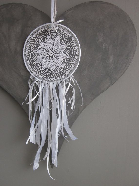 A vintage lace doily dream catcher in white shades by SierGoed, €24.95