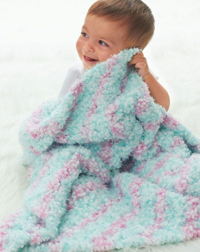 Crochet this corner to corner blanket using Bernat Happy Yarn. Super soft yarn that is intended for kids and babies. It gives the afghans a luscious full look and an incredible soft feeling.