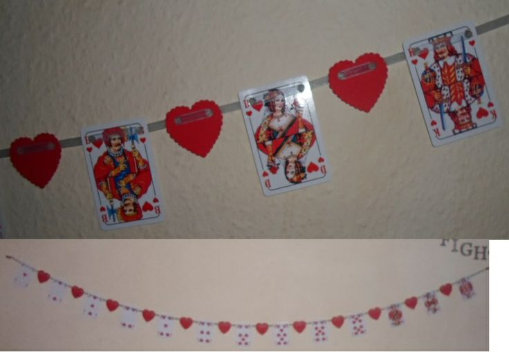 Valentine garland made out of playing cards (only the cards with hearts on) and red cardboard for the hearts.