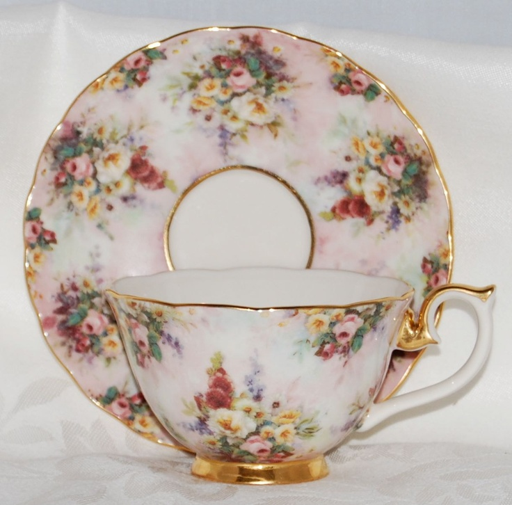 """Rare and seldom seen a Lena Liu Tea Cup and Saucer from the """"Glorious Chintz"""" collection. This one is titled Remembrance and is a soft pink, trimmed in 14 carat gold with chintz flowers scattered all over it. Just lovely and in mint condition."""