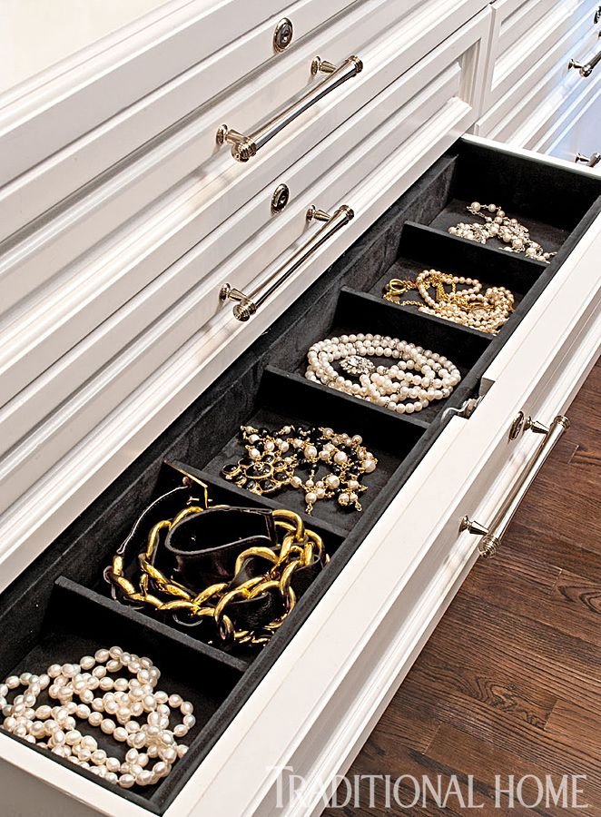 Drawer inserts create an appealing display for jewelry and keep pieces from getting tangled. - Photo: Michael Garland / Design: Lisa Adams