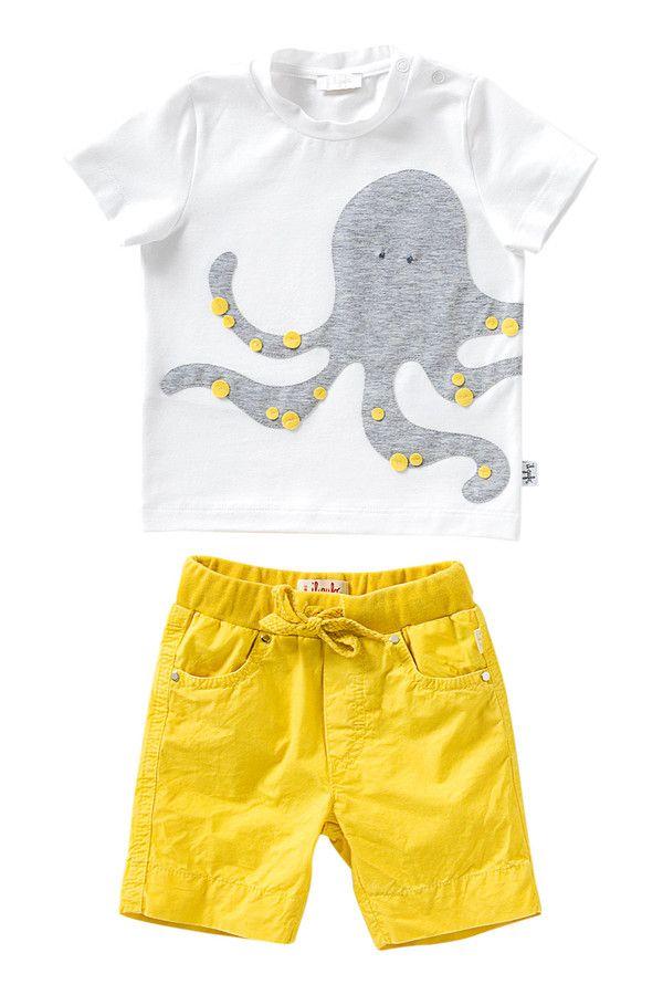 T-SHIRT CON APPLICAZIONE LATERALE T-shirt in morbido jersey stretch bianco e scollo rotondo. Dettaglio super cool: una maxi applicazione divertente che continua sul lato.