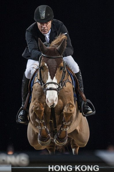 Michael Whitaker of Great Britain rides Viking at the Longines Grand Prix during the Longines Hong Kong Masters International Show Jumping at Asia World Expo on March 2, 2013 in Hong Kong,