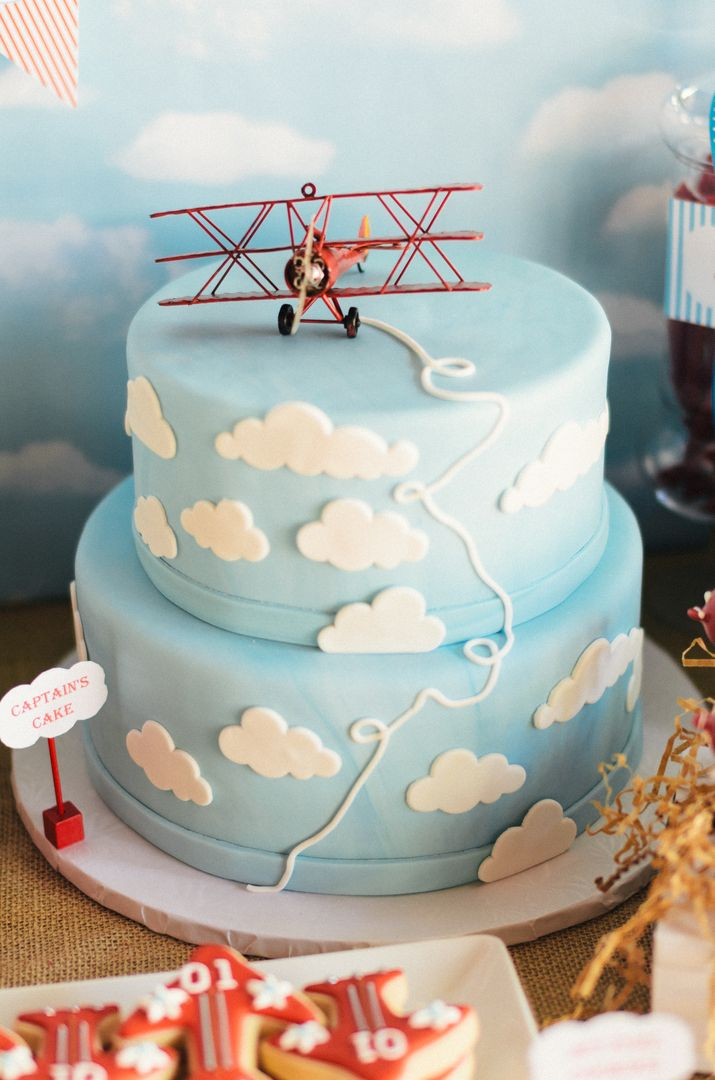 Captain's Birthday Cake with vintage toy airplane