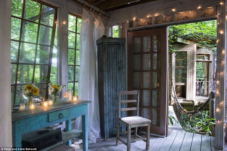 Floor-to-ceiling windows flood the interior with natural light, while pretty fairy lights ...