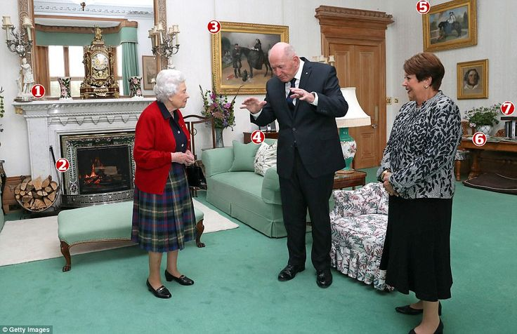Timeless elegance: The Queen with Sir Peter Cosgrove, Governor General of Australia, and Lady Cosgrove in the drawing room at Balmoral Castle today. Pictured: 1. A set of white figurine candlestick holders that are believed to have been used by Queen Victoria in the mid-1800s; 2. A fireplace trim featuring a repeating thistle motif in a nod to Scotland's national flower; 3. A painting of Queen Victoria and her trusted ghillie John Brown at Osborne House on the Isle of Wight; 4. An iPod…