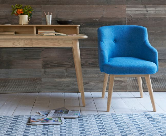 At last, a desk chair that looks the part and is every bit as comfy! With its smart set of oak legs, this game changer tucks snugly up to the desk.