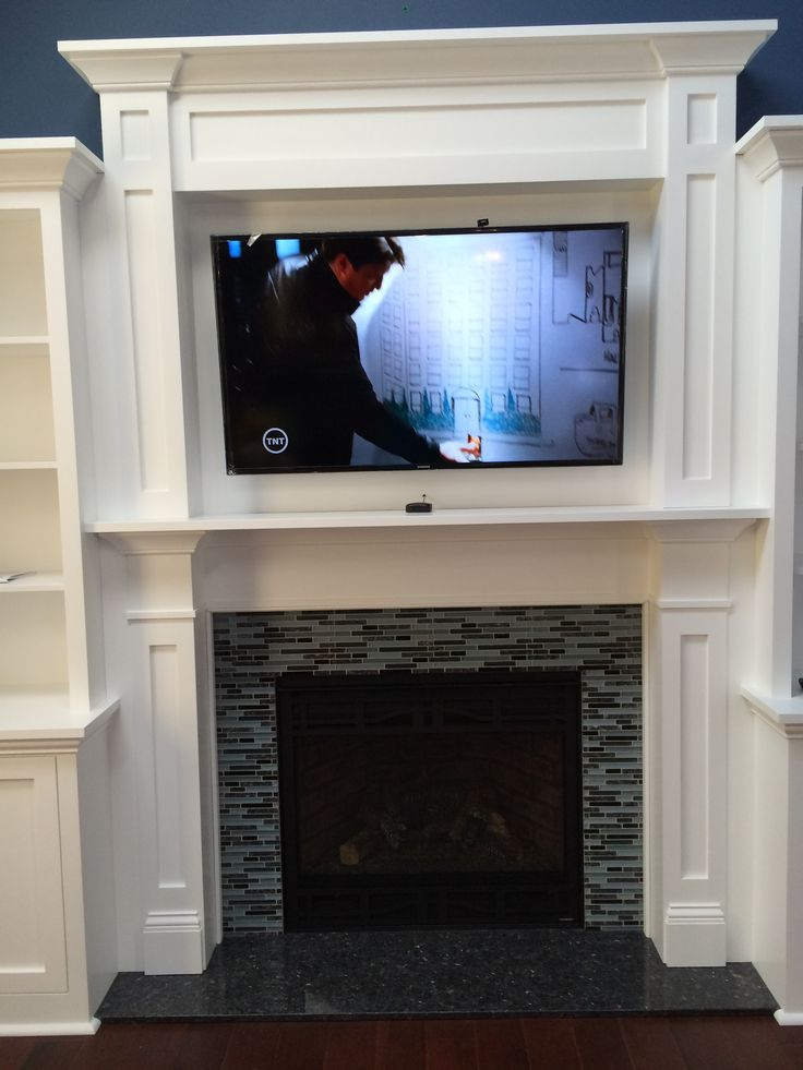 Heatilator Gas Fireplace NNXT surround in blue pearl granite hearth with blue pearl mosaic With