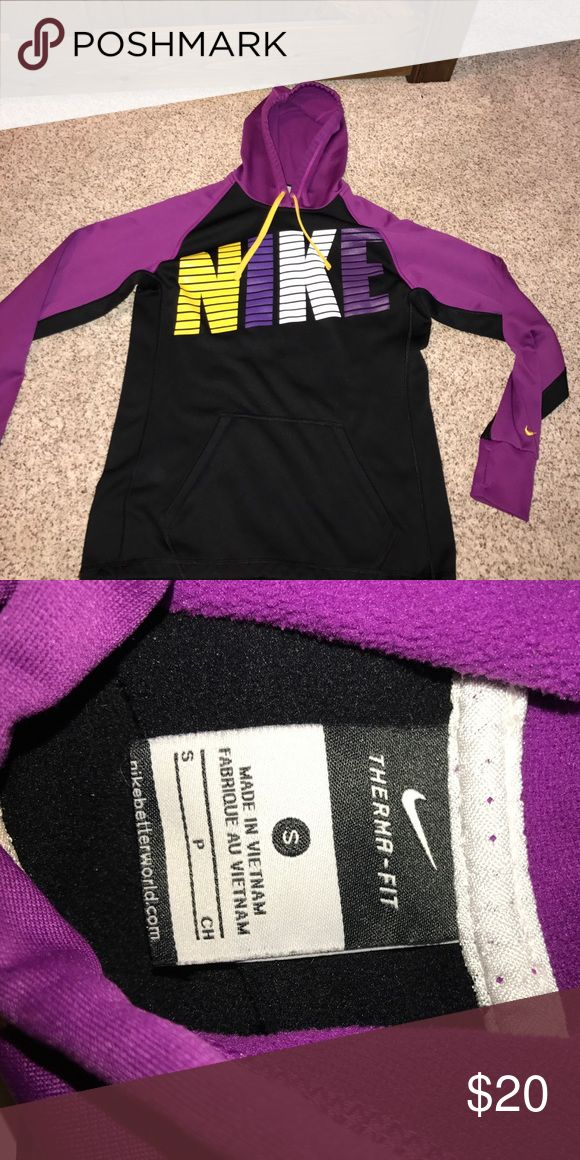 Women's Nike hoodie Black yellow purple magenta and whites women's Nike hoodie. Excellent condition. Extremely comfortable material. It does have a cinch waistband and thumb holes on the sleeves. Size small and is fleece lined. Nike Jackets & Coats