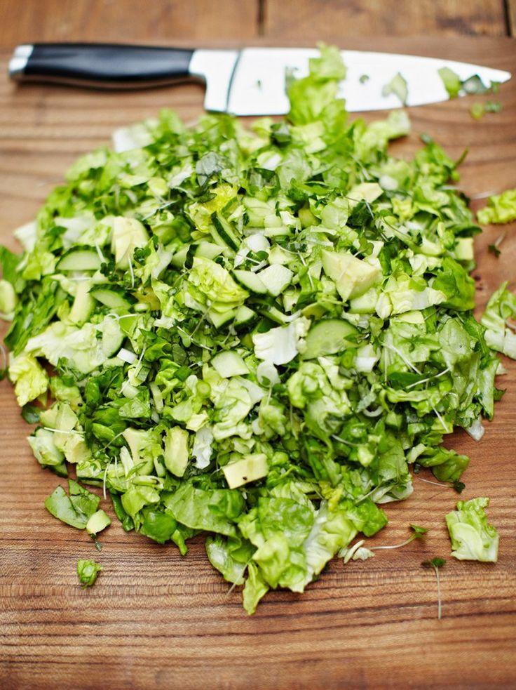 Simple chopped salad - 4 spring onions 1 cucumber a few sprigs of fresh basil 2 small ripe avocados 1 round lettuce 1 punnet of cress 3 tbsp extra virgin olive oil 1 lemon sea salt freshly ground black pepper