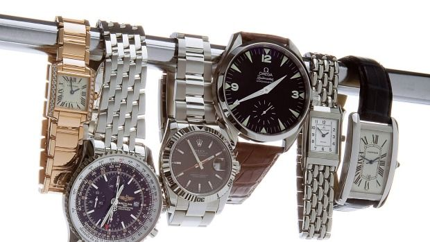 Thieves smashed a window to steal hundreds of thousands of dollars' worth of watches in Bulimba.