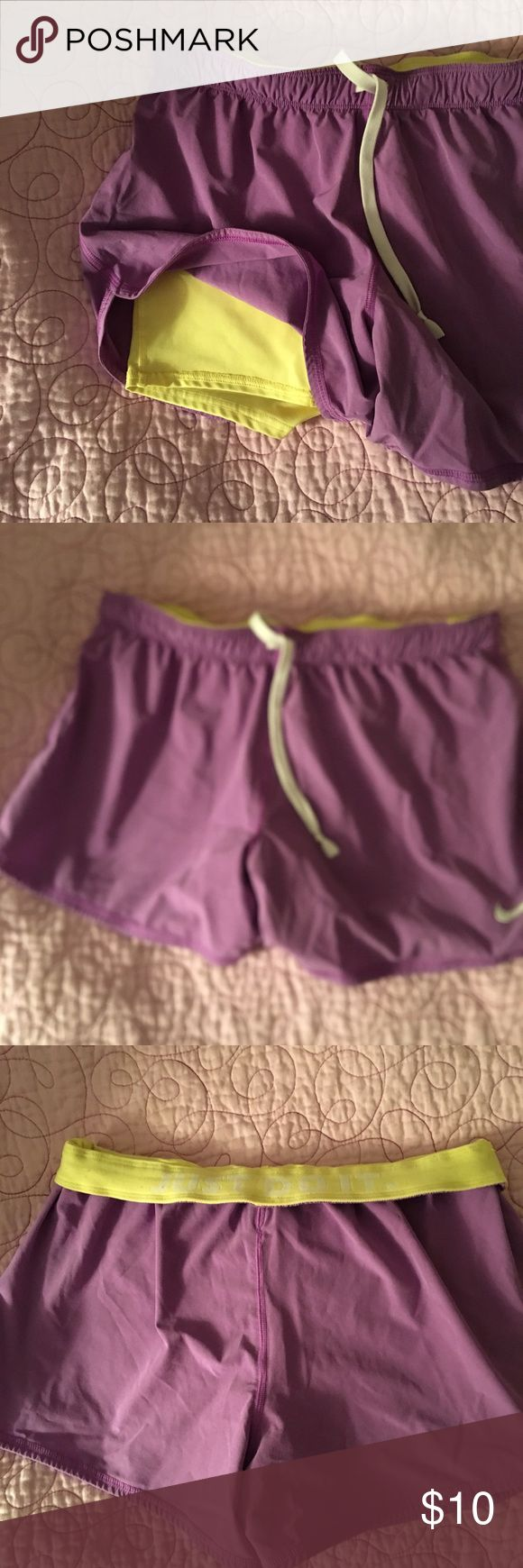 Nike Pro Combat Shorts Nike Pro Combat Shorts. Yellow compression short with purple overlay Nike Shorts