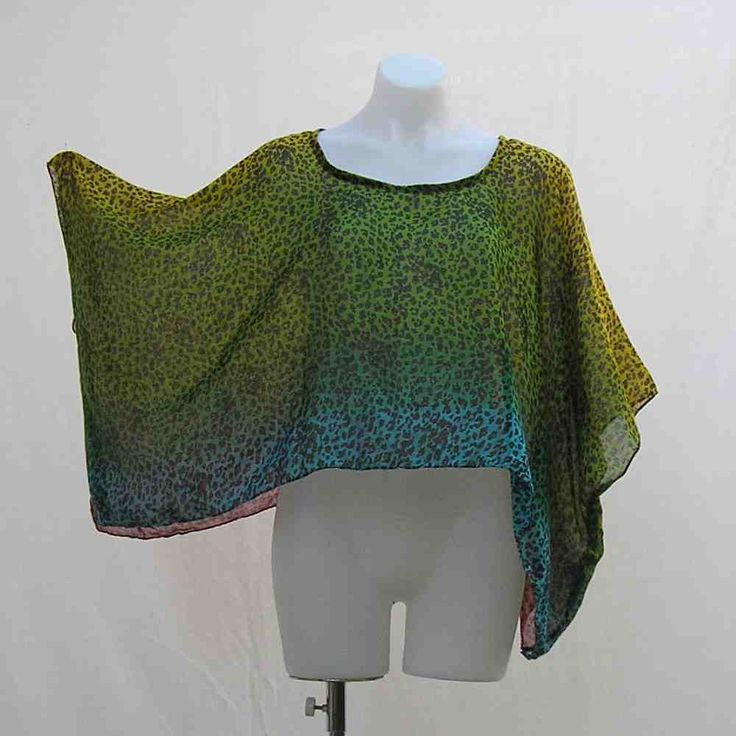 This leopard print shrug in a rainbow of hues makes a great cover up in the sun, or a light layer for a little extra warmth in the evening. Plus size Shrug, crop top, cover up, bolero, one size fits most, leopard animal print rainbow, boho, bohemian, OOAK, one of a kind by Rethreading on Etsy, AU$35