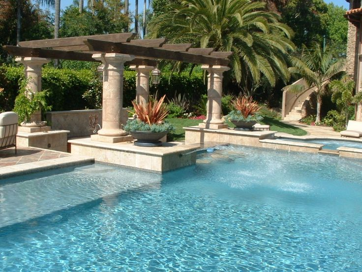 Raised deck boxes with fountain heads. Swim up bar and