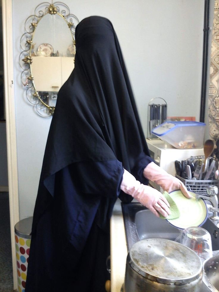 Proud Niqabi cleaning her house