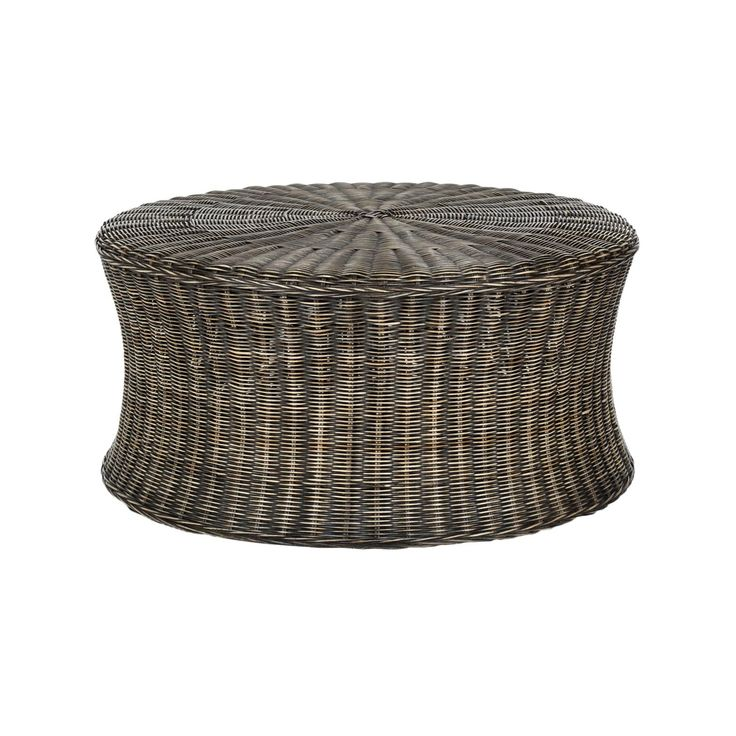 This Low Profile Rattan Coffee Table Also Doubles As An Ottoman For Extra Seating Its