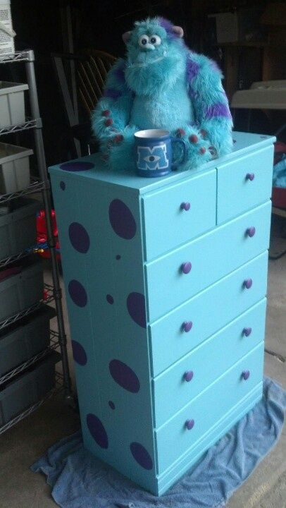 We painted a hand me down dresser for the boys room to look like sully from monsters inc.