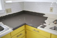 Concrete over formica countertop in kitchen