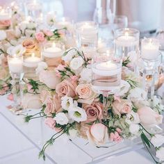 How romantic are these centrepieces with the flowers and candles?   How will you decorate your tables?   www.wed2b.co.uk