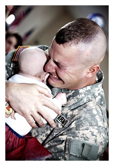 Soldier meets his baby son for the first time...