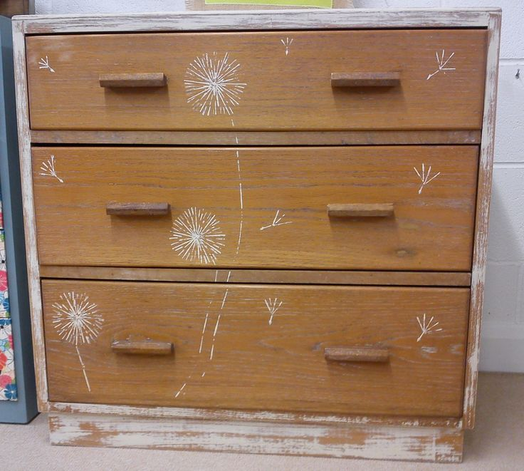 Dandelion painted chest of drawers, utility furniture.