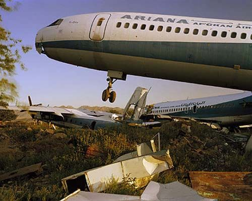 Wrecked Ariana Afghan Airlines jets at Kabul Airport pushed into a mined area at the edge of the apron. Photos by Simon Norfolk.