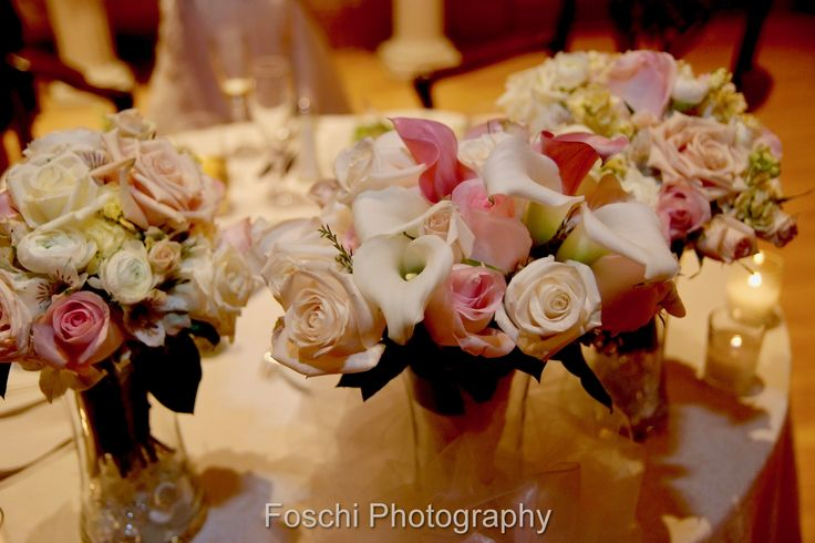 An ideal suggestion to repurpose the bouquets after the ceremony for Nicole and Ryan's reception at Hotel DuPont.