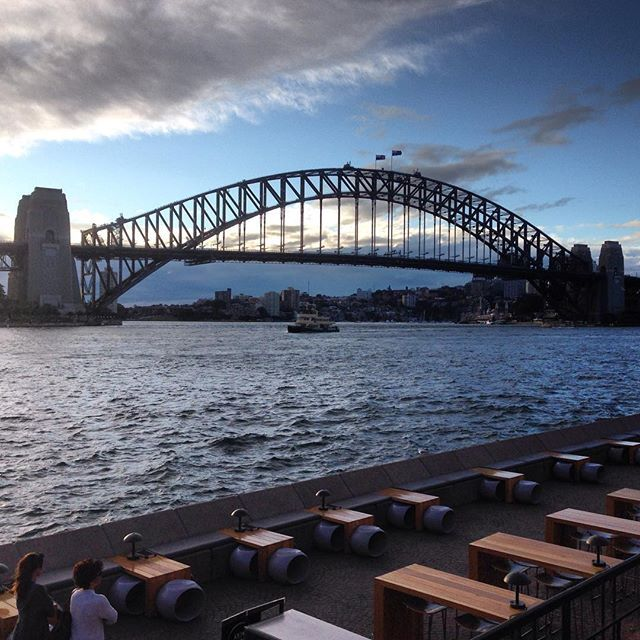 The #bridge that needs little introduction #Sydney #Harbour Bridge. In the lower foreground is the extensive Opera #Bar. #travel #tourism #tourist #NSW #Australia  #water #adventure #explore #city #architecture #engineering #design #attraction