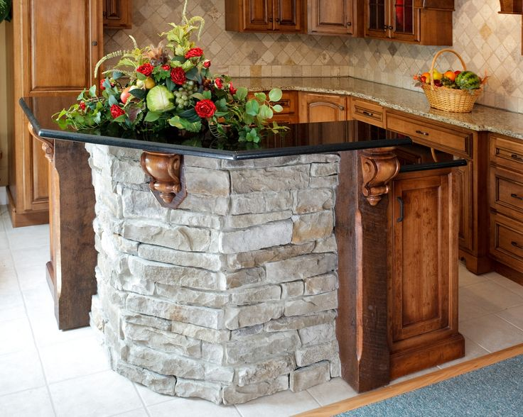 Glittering Stacked Stone Kitchen Island With Black Galaxy Granite Countertop Also Decorative Wood Corbels For Raised Breakfast Bar Design Of Ideas