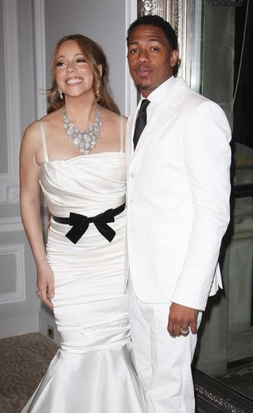 Mariah Carey Photos Photos - Singer Mariah Carey and her husband Nick Cannon at a photocall celebrating their re-newed wedding vows at the Plaza Athenee hotel on Avenue Montaigne in Paris. The couple then went to dine at the Jules Verne restaurant on top of the Eiffel Tower. They got married on April 30, 2008. - Mariah Carey and Nick Cannon Renew Their Vows in Paris