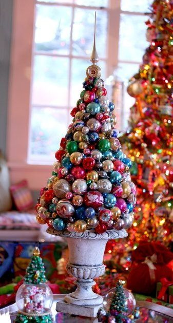 This tabletop topiary was made from a Styrofoam cone, glue and Christams ornaments. Mark Ballard. by terra