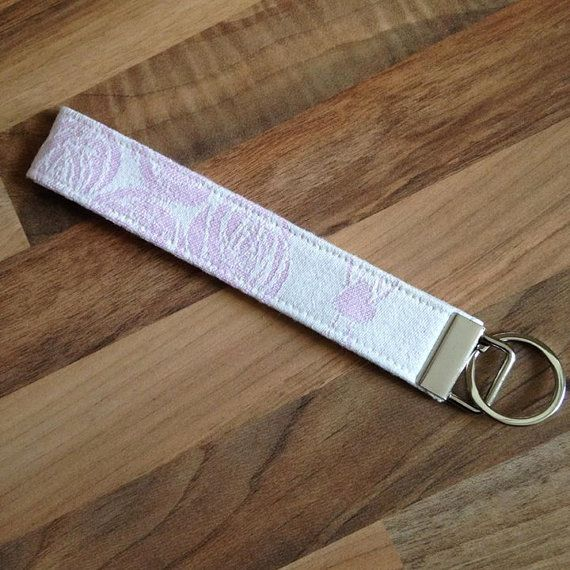 Key Fob Jacquard Keyring made with Oscha Roses Islay wrap scrap  It is stylish as well as functional; easy to find in your bag, you can also loop it around your wrist and have your hands free.    If you have any questions, please feel free to send me a message!  You can also find me on Facebook https://www.facebook.com/pages/Girls-Got-Fabric