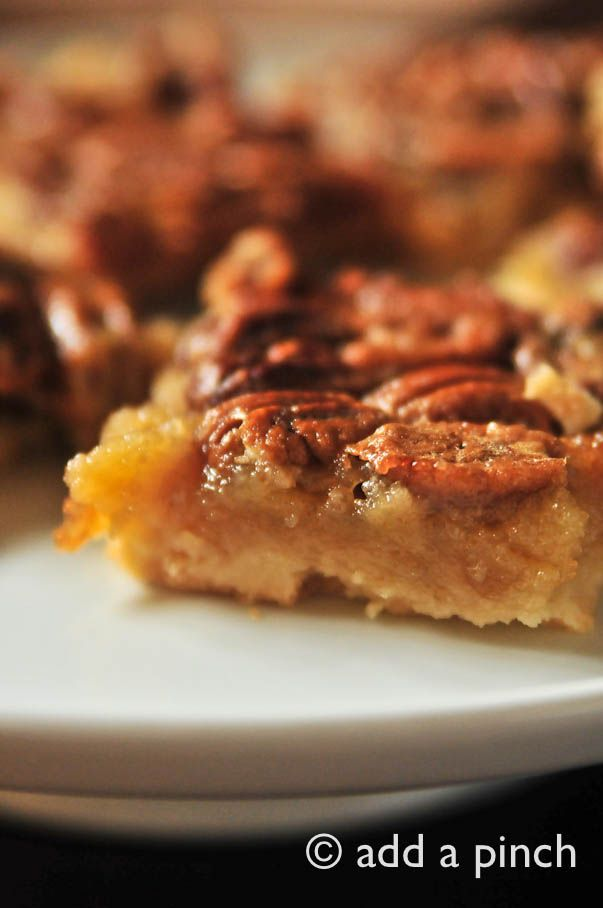 Pin ItOh boy, do I have a treat to share with you! These Pecan Pie Bars are absolutely scrumptious and something I think you'll want to make soon!The shortbread crust topped with pecan pie makes an impressive addition to any holiday table or for entertaining. Even my pecan-pie-hatin' brother-in-law loves these and my Mama requests them instead of Southern Pecan Pie now. {But, shhh don't tell anyone or she might be evicted from the south}Now, I