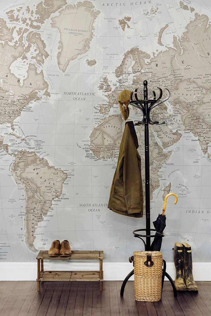Add some personality to your hallway with this intricate world map wallpaper.