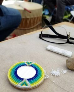 Finally getting to finish the earrings I started in December. Nevermind the gum, lol! #SpringBreak #MeTime #beadwork #powwow #nativebeadwork