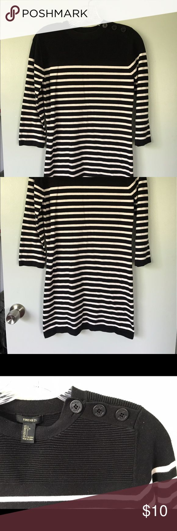 Nautical Sweater Dress This Forever 21 sweater dress has cute Nautical details. The buttons along the shoulder are the perfect touch! This dress is great with a pair of leggings and cute knee high boots! Size says Large, fits more like a Small. Forever 21 Dresses Long Sleeve