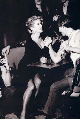 arm wrestle. Catherine Deneuve photographed by Ellen Von Unwerth for Yves St Laurent