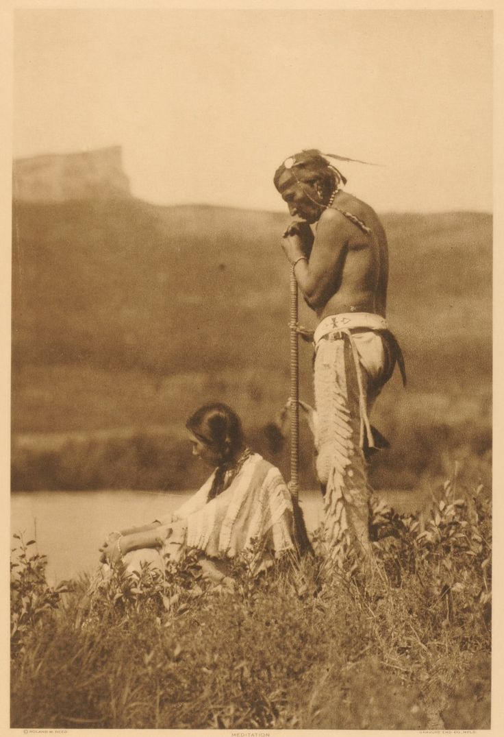 Piegan Man and Woman by Roland W. Reed, no names, location or date. Chief Mountain in the background.