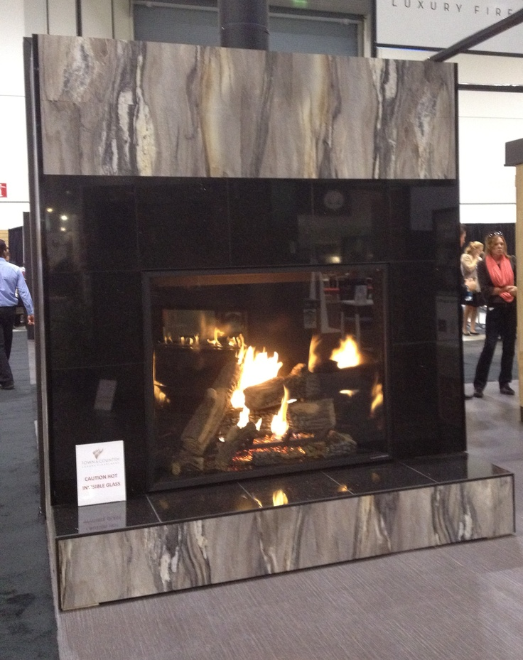 We stepped out of our booth at IIDEX/NeoCon Canada 2012 and look what we found … a real head-turner in the Town & Country Luxury Fireplaces booth. What do you think about our Dolce Vita 180fx® laminate on this fireplace?