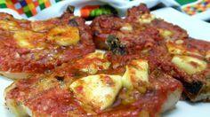 Bistecche+di+maiale+alla+pizzaiola+al+forno