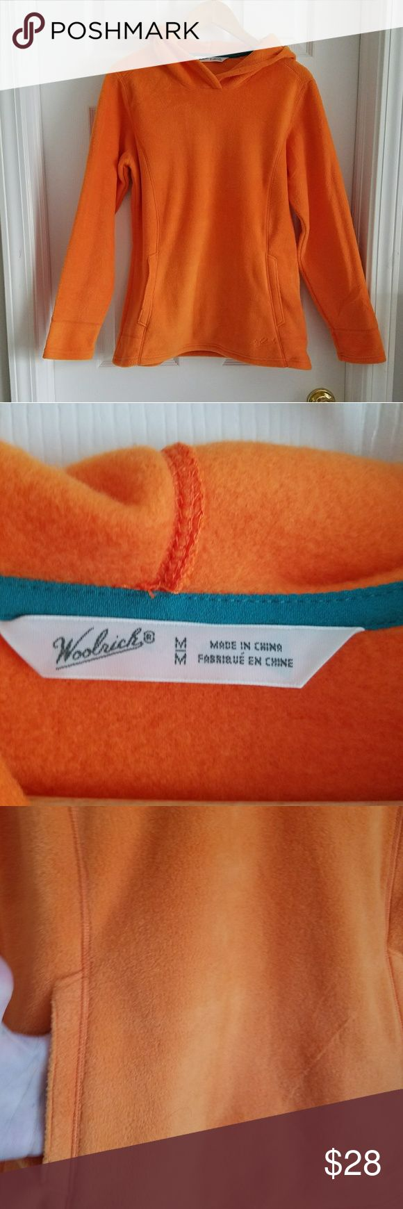 Woolrich Women's Orange Soft Fleece Hood pullover Beautiful, like new orange Woolrich hooded pullover. Never worn, just took the tags off. Super soft and cozy. Size medium Woolrich Tops Sweatshirts & Hoodies