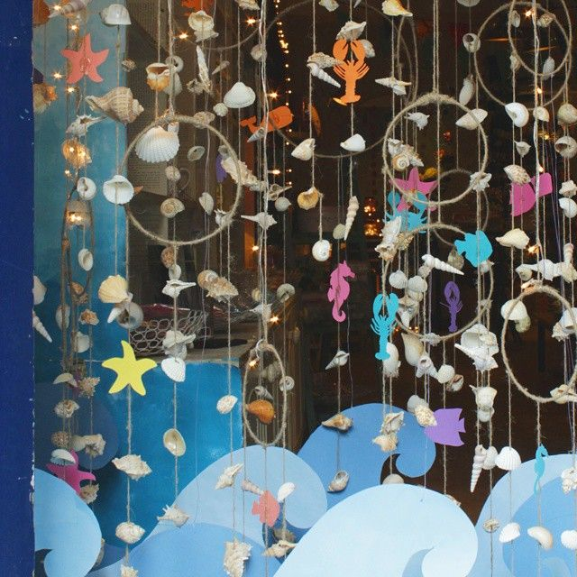 ....Dreaming of a beach summer  vacation. Our May #windowdisplay.  #thewishingchair #beach #vacation #lovetheocean #seashells #waves #seahorses