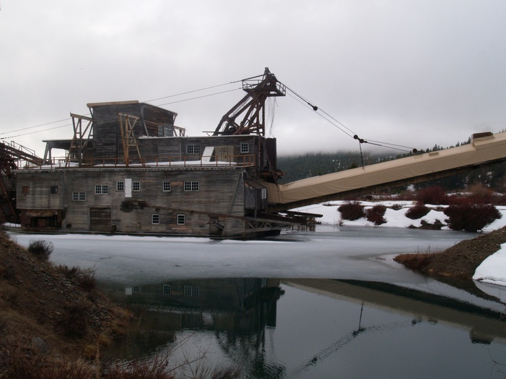 Dredge #3 sits in a pond it created as it was searching for gold in the Powder River. Sumpter Oregon