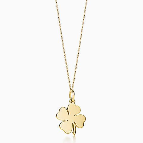 Four Leaf Clover charm in 18k gold, on a chain.