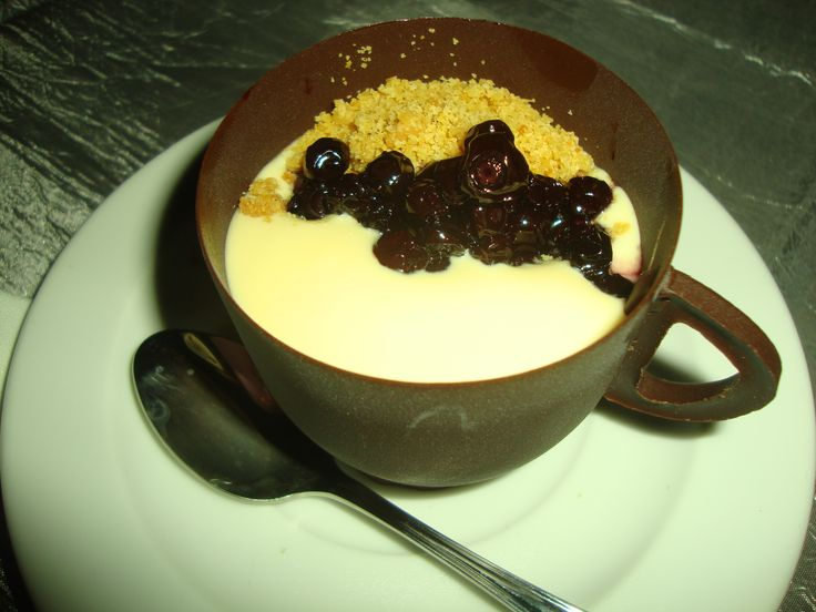 Chocolate cup of Dulce de Leche Parfait with spiced huckleberry compote, citrus shortbread crumbs and crystallized Thai ginger