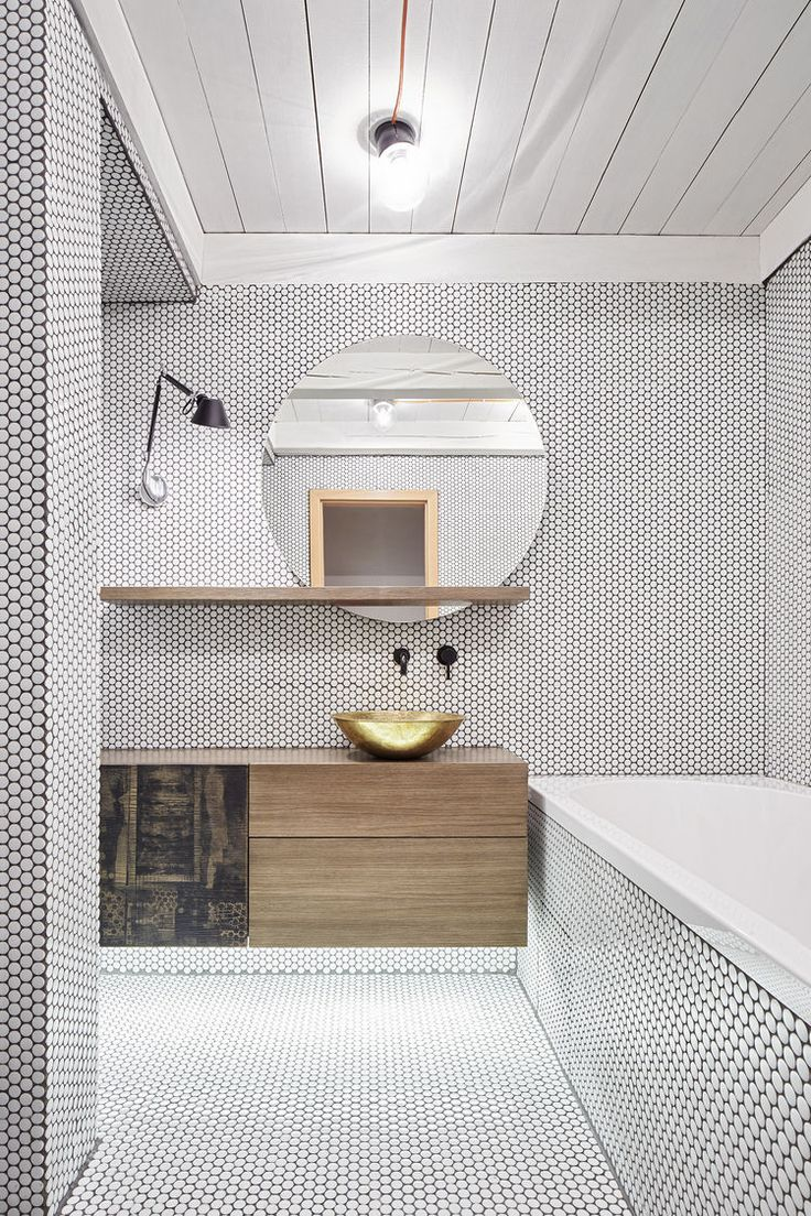 Wow look at all this tile and love the wood with brass in this bathroom - beautiful!