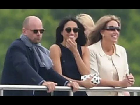 Meghan Markle watches Prince Harry play in the Audi Polo Challenge at Co...