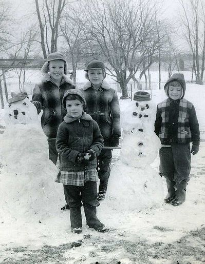 Classic winter scene from the 1950s-girl's had their dresses on over their snowpants!